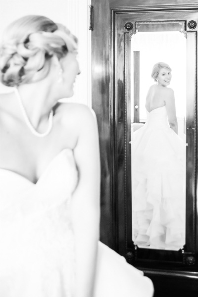 bride looking at reflection