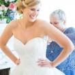 bride smiling with hands on hips